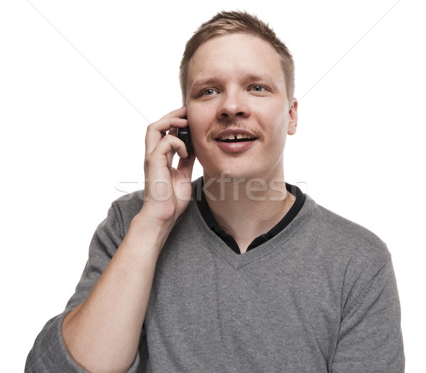 Happy young man speaking on telephone. Stock photo © Reaktori