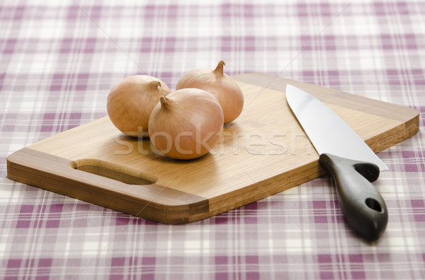 Onions and knife on cutting board. Stock photo © Reaktori