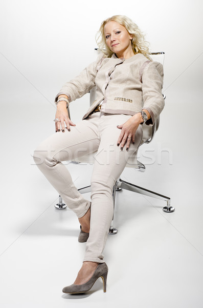 Realxed woman sitting on a chair. Stock photo © Reaktori