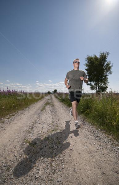 Uruchomiony człowiek mężczyzna długo prosto Zdjęcia stock © Reaktori