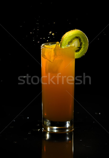 Orange dink with splashing ice cube. Stock photo © Reaktori