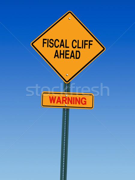 Fiscale klif vooruit waarschuwing richting verkeersbord Stockfoto © RedDaxLuma