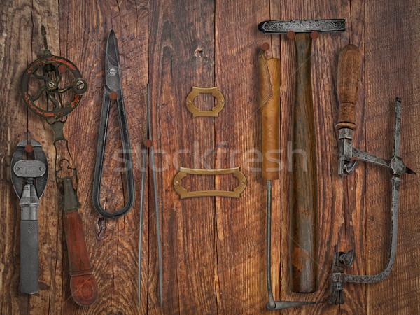 vintage jeweler tools over wooden wall Stock photo © RedDaxLuma