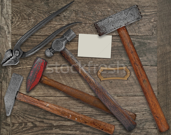 Stock photo: blacksmith tools and business card over bench