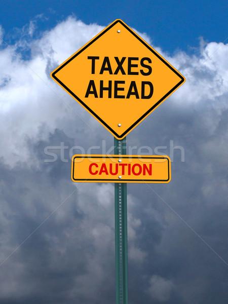 caution taxes ahead post sign Stock photo © RedDaxLuma