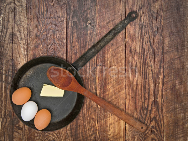 vintage set for frying eggs over wooden table Stock photo © RedDaxLuma
