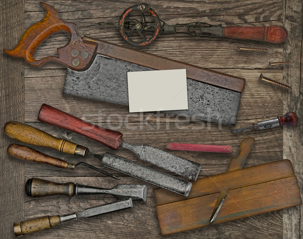 woodworking tools and business card over bench Stock photo © RedDaxLuma