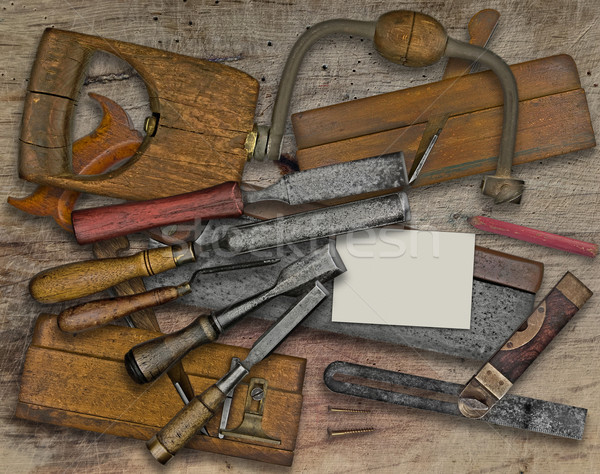 Stock photo: woodworking tools and business card over bench