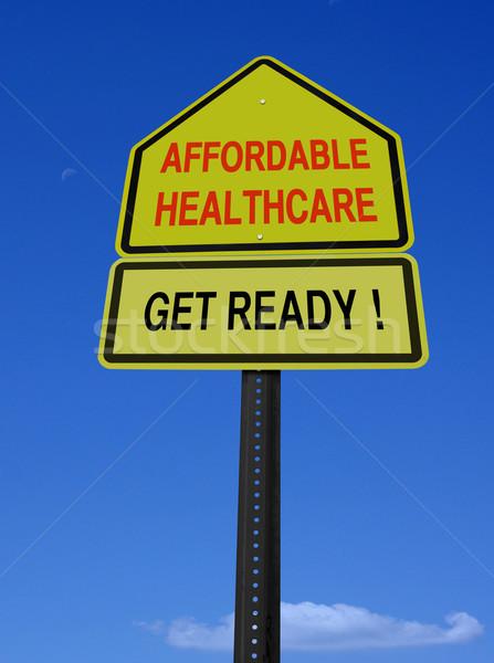 Uygun sağlık imzalamak hazır mavi gökyüzü iş Stok fotoğraf © RedDaxLuma