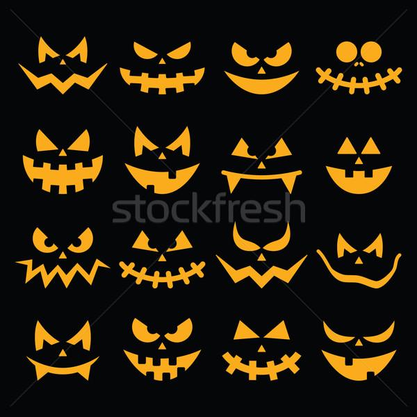 Stock photo: Scary Halloween orange pumpkin faces icons set on black