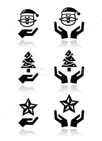 Hands with christmas icons - santa claus, tree, star Stock photo © RedKoala