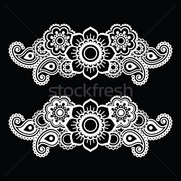 Mehndi, Indian Henna tattoo white pattern on black Stock photo © RedKoala