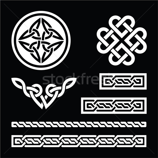 Celtic white knots, braids and patterns on black background Stock photo © RedKoala
