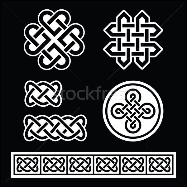 Celtic Irish patterns and braids on black background Stock photo © RedKoala
