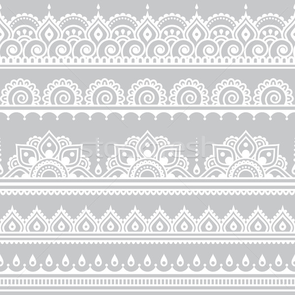 Mehndi, Indian Henna tattoo seamless white pattern on grey background Stock photo © RedKoala