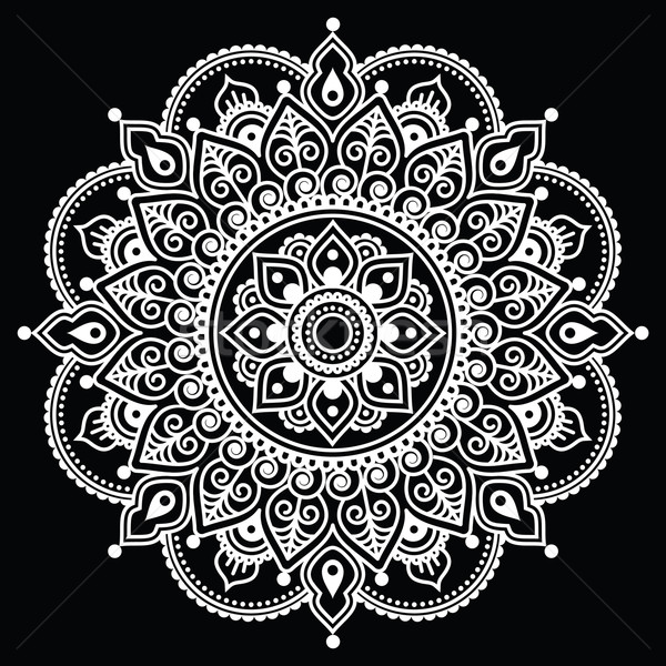Mehndi, Indian Henna tattoo white pattern on black background Stock photo © RedKoala