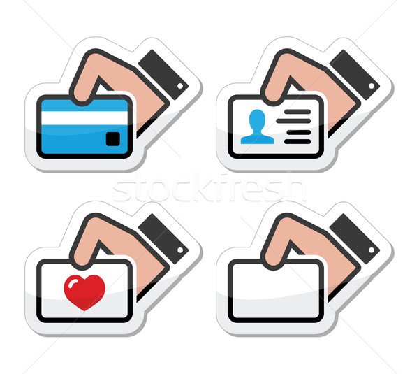 Hand holding credit card, business card, ID icons set as labels Stock photo © RedKoala
