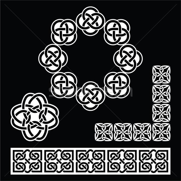 Irish Celtic patterns, knots and braids on black Stock photo © RedKoala