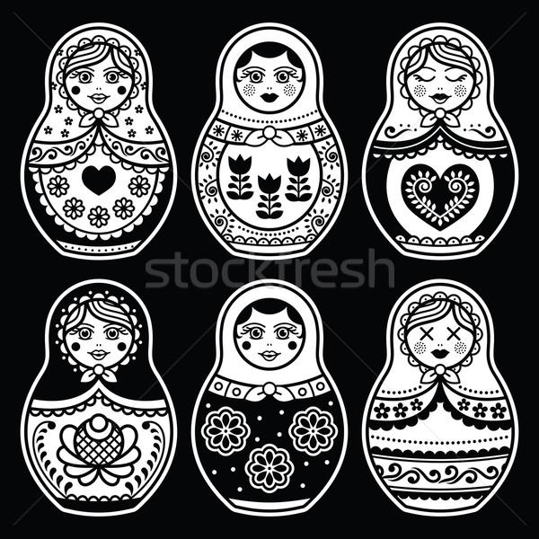 Matryoshka, Russian doll white icons set on black Stock photo © RedKoala
