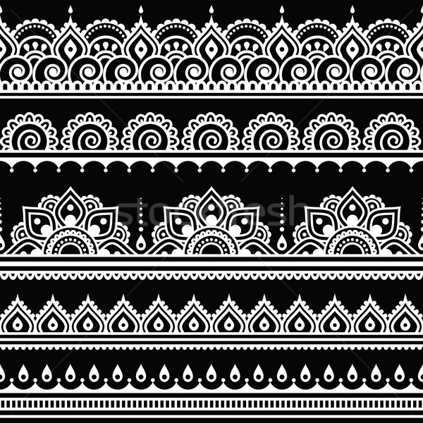 Mehndi, Indian Henna tattoo seamless white pattern on black background Stock photo © RedKoala