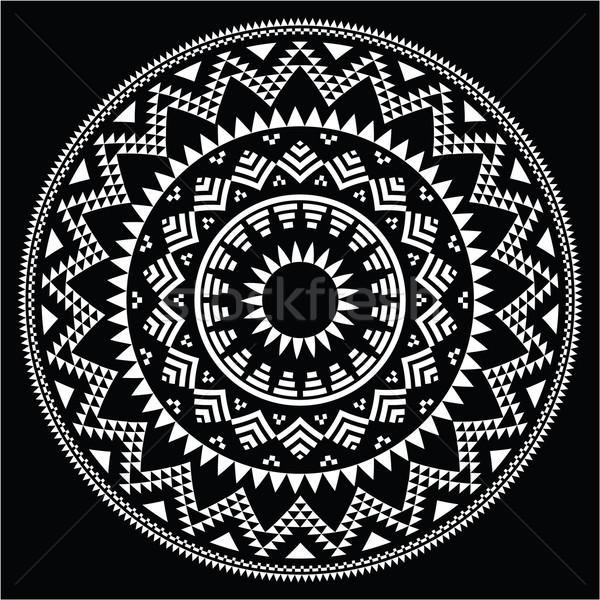 Tribal folk round Aztec geometric pattern on black Stock photo © RedKoala