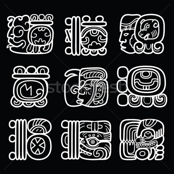 Maya glyphs, writing system and language vector design on black background Stock photo © RedKoala