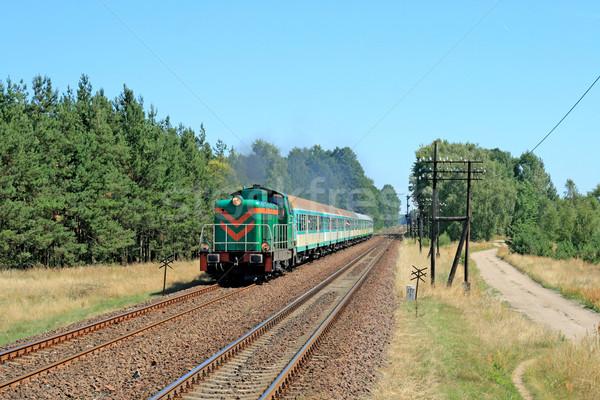 Passenger train passing through countryside Stock photo © remik44992