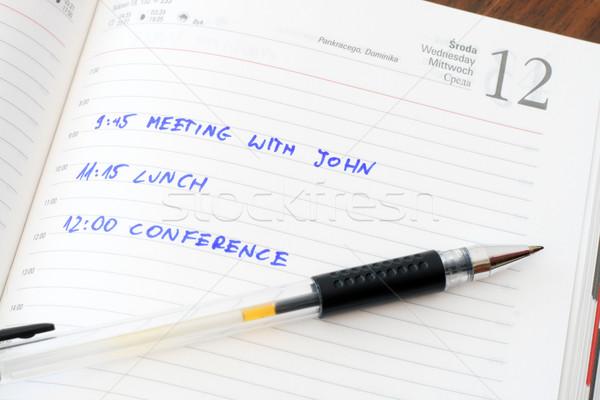 Journal note stylo table en bois papier livre Photo stock © remik44992