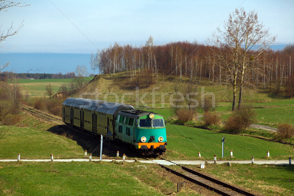 Passenger train passing through countryside Stock photo © remik44992