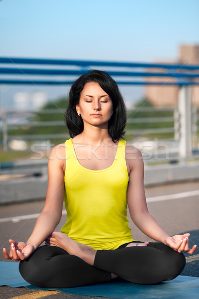 Stock photo: Woman doing stretching yoga exercises outdoors