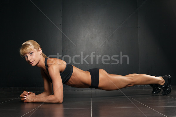 fit sportive  woman doing plank core exercise  Stock photo © restyler
