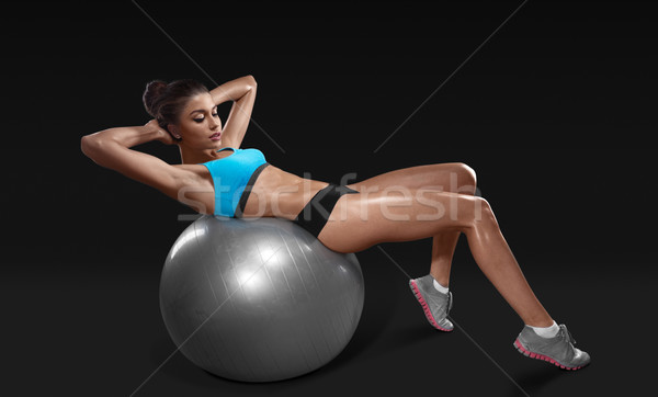 Fitness young woman doing abdominal crunch on fitness ball Stock photo © restyler