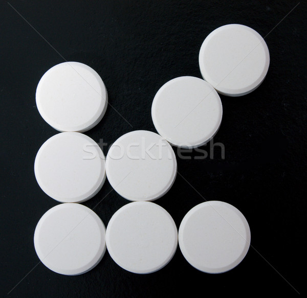 arrow of white tablets Stock photo © restyler