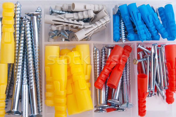 Screws and plugs in plastic toolbox, top view Stock photo © restyler