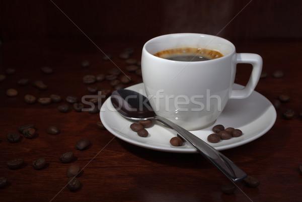 Xícara de café grãos de café escuro espaço tabela café Foto stock © restyler