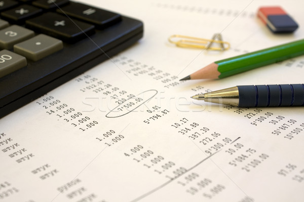 calculator, pen, a pencil lay on the financial report Stock photo © restyler