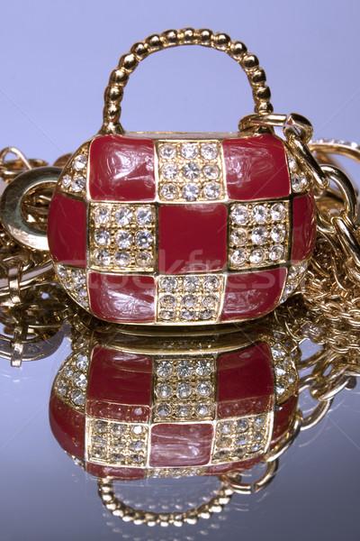 Precious ladies' handbag on a mirror with reflection  Stock photo © restyler