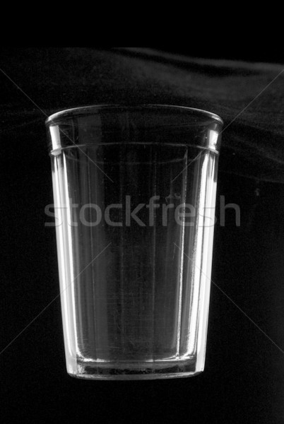 Thick glass tumbler on black Stock photo © restyler