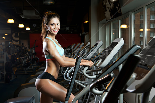 beauty girl workout exercise on elliptic bike Stock photo © restyler
