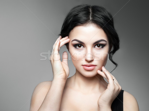 Beautiful Young Woman Touching Her Face Stock photo © restyler