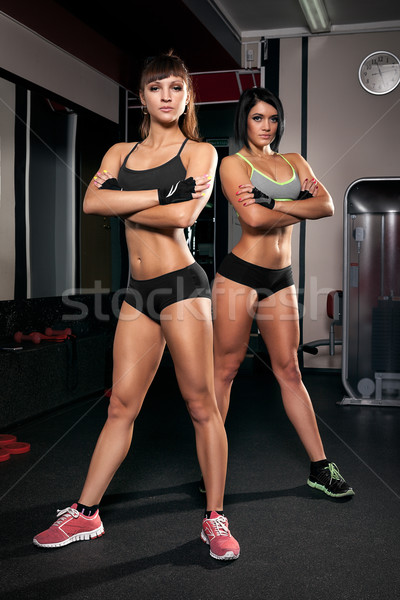 two sports girl in the gym Stock photo © restyler