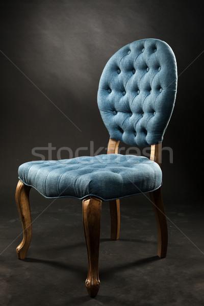 Antika mavi kadife sandalye karanlık oda Stok fotoğraf © restyler