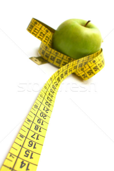 Apple with measure tape Stock photo © restyler