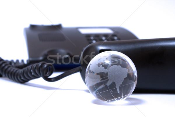 Negócio telefone vidro globo preto azul Foto stock © restyler