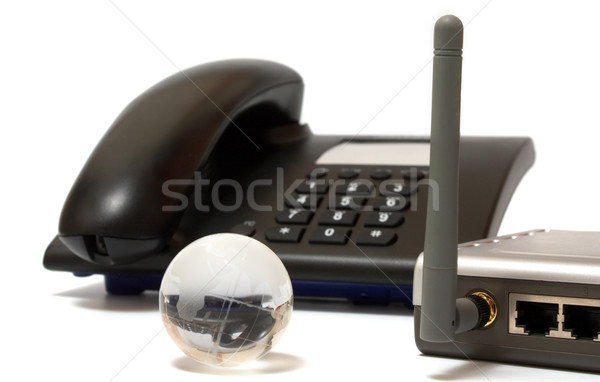 Office phone, wi-fi router and glass globe Stock photo © restyler