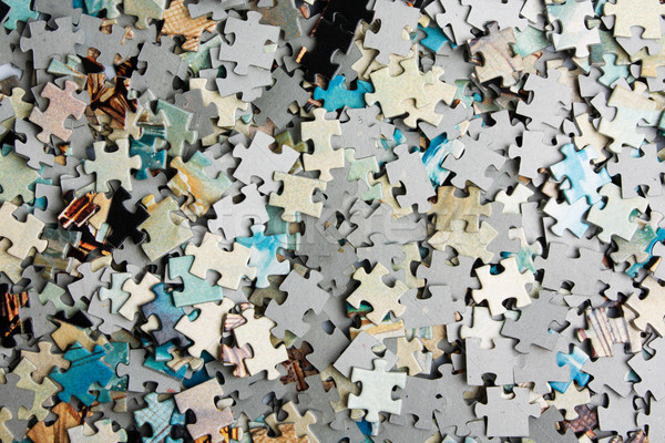 Unsolved bunch of puzzles Stock photo © restyler