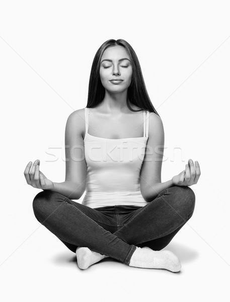 Mutlu genç kadın oturma lotus pozisyon portre Stok fotoğraf © restyler