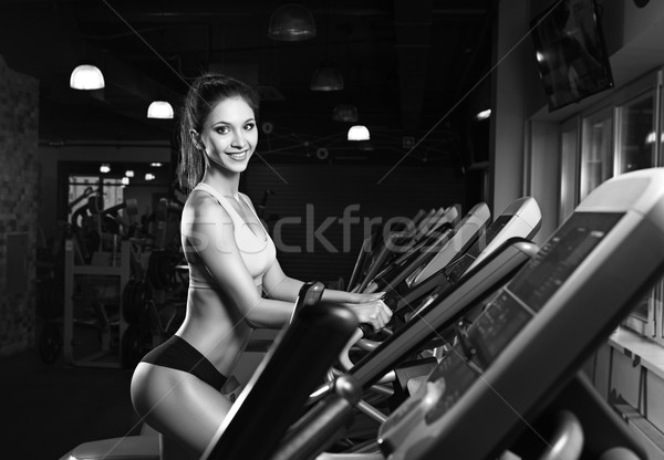 Stock photo: beauty girl workout exercise on elliptic bike
