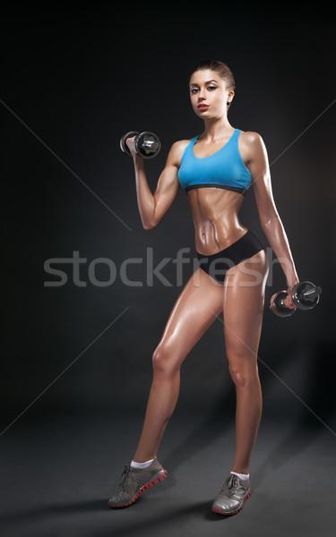 фитнес девушки гантели темно изолированный Сток-фото © restyler