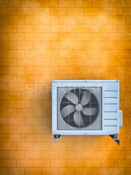 Condizionatore d'aria illustrazione 3d muro di mattoni casa estate arancione Foto d'archivio © reticent